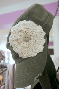 Women's cap with crocheted flower